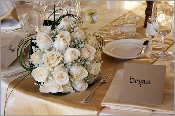 ivorygoldbridalbouquet The arrangements of the tables were surely a