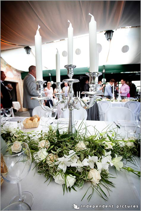 centerpieces with candelabras and flowers