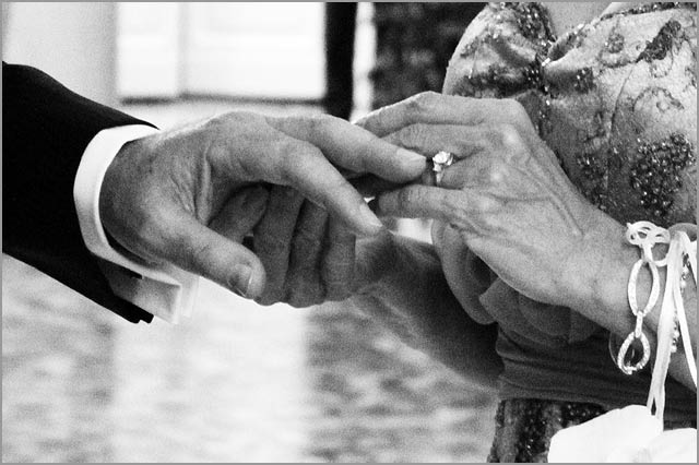 Bride and groom exchanging rings Italy