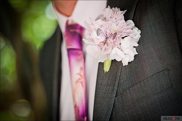wedding buttonholes with peonies and butterflies