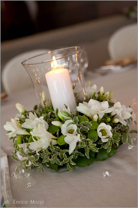 wedding centerpiece with candles by Stresa florist