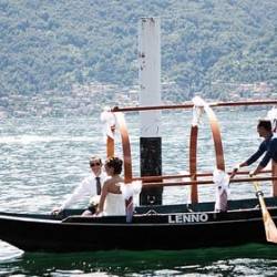 "Getting married at Lake Como, bride and groom arrive by traditional row-boat ""Lucia"""