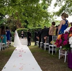 Orange and fuchsia wedding at Scuderie Odescalchi in Bracciano