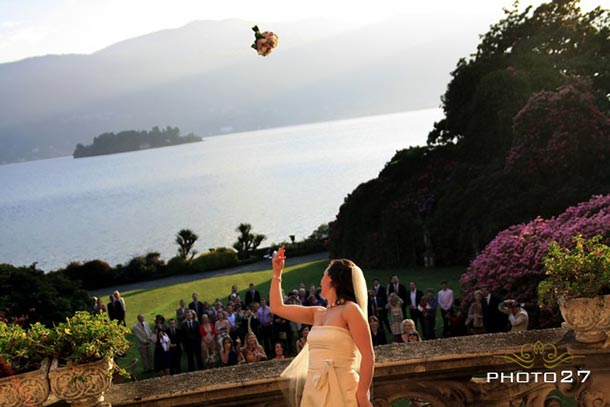 Sheila and Colman's wedding - April 2011 Sheila is throwing her bridal bouquet from the wonderful balcony of Villa Rusconi - photo by Photo27
