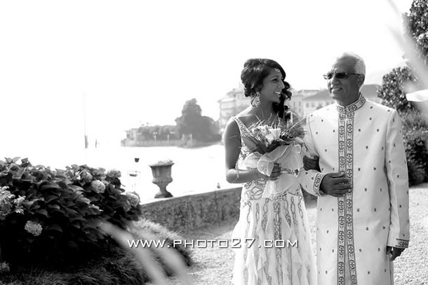Rani and Edward's wedding - July 2010 An ethnic wedding at Villa Rusconi. Rani's Indian wedding, here she comes with her dad reaching the aisle. Photo by Photo27