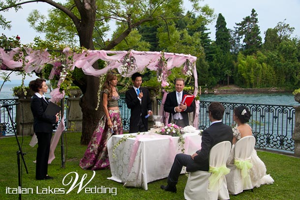 Lina and Borja's wedding - July 2010 Ceremony Gazebo arrangement with pink organza and flowers Photo by Italian Lakes Wedding