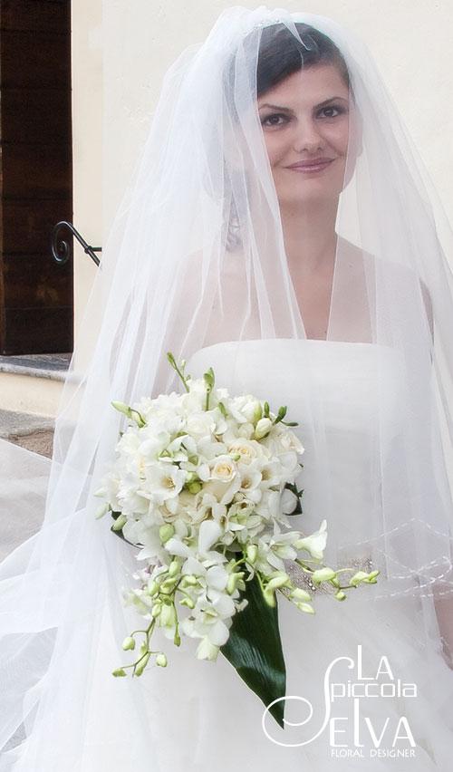 bridal-bouquet-roses-orchids-freesies