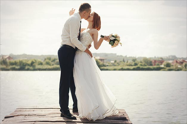 Wedding Couple Kissing On The Lake